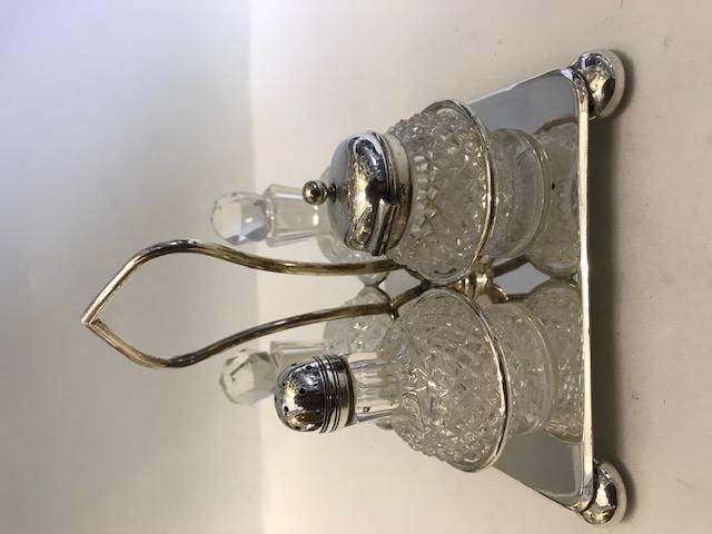 Antique silver plated Cooper Bros elaborately cut glass four bottle cruet (c.1900)