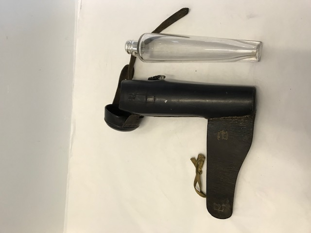 Antique silver plated mounted glass hunting flask with a sturdy brown leather holster with a strap and buckle (c.1880)